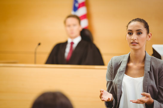 female lawyer in courtroom, addressing jury