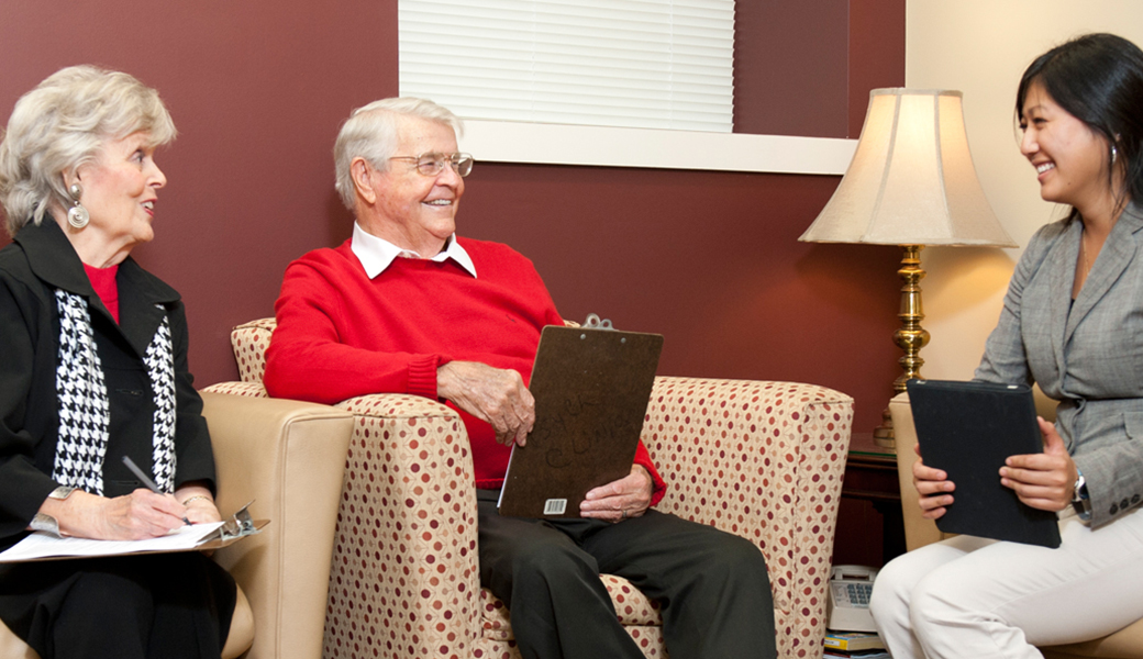 psychologist talking with an older couple