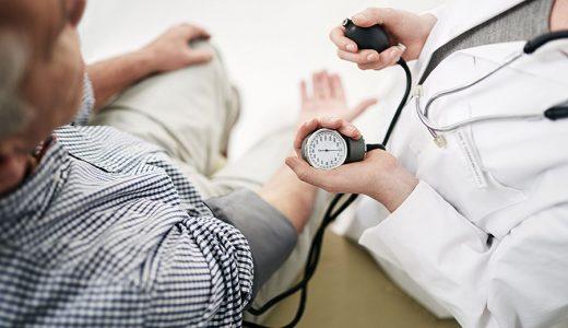 patient having blood pressure measured